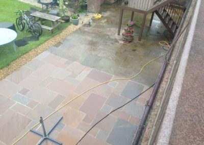 Indian Sandstone patio during pressure washing