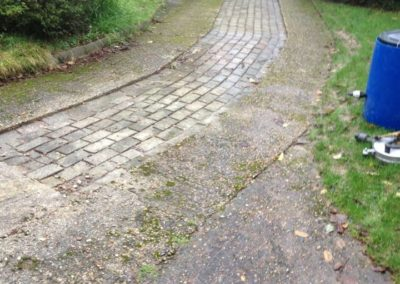 Brick and concrete driveway before cleaning