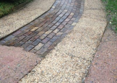 Brick and concrete driveway after cleaning