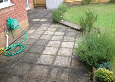 Concrete slab patio before cleaning