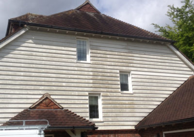 exterior cladding on house before pressure washing